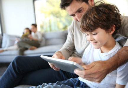 Father and son on an tablet together